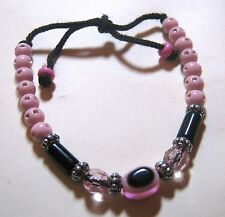 Great fun friendship style bracelet with small pink beads and evil eye bead