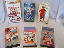 Lot - 6 VHS Classic Christmas Movies Rudolph Grinch Santa Clause Vacation Story