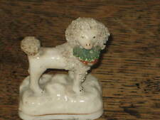 EARLY TO MID 19C STAFFORDSHIRE  DOG POODLE FIGURE BASKET IN MOUTH