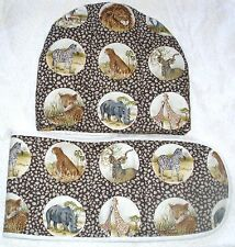 On Safari lions, giraffes, leopards, cheetahs zebras teacosy and oven glove set