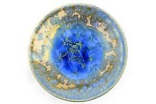 An unusual Frank Laine studio pottery bowl. Bright blue floral design