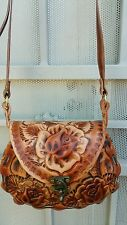 Authentic handmade girls hand tooled leather purse with traditional flowers