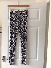 BRAND NEW LADIES 'H & M' NAVY LEOPARD LEGGINGS. SIZE 8. FULL LENGTH. LABEL ON.
