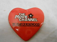 VINTAGE PINBACK BUTTON #48- 096 - MOVIE CHANNEL - HEART SHAPED