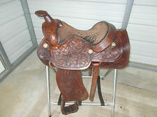 "15 1/2"" older Circle F Roping saddle with tooling and big roping stirrups"