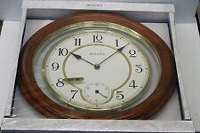 "SOLID WOOD 14 "" WALL CLOCK IN DARK OAK  MADE BY THE BULOVA CLOCKCOMPANY C4596"