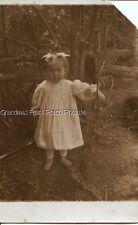 RPPC PRECIOUS LITTLE GIRL w HAIR BOW OUTDOORS ANTIQUE PHOTO POSTCARD c 1910