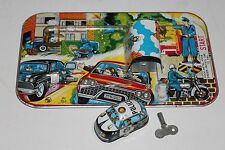 Vintage 1960'S TPS MECHANICAL WIND UP  TIN POLICE CAR with TIN MAZE TRACK