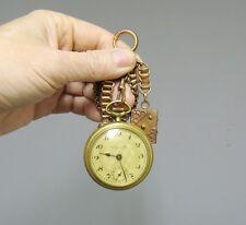 Ancienne montre à gousset chronomètre, avec sa chainette et portrait de famille.