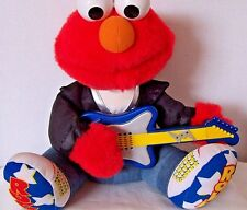 1997 Tyco Rock and Roll Sesame Street animated guitar playing Elmo plush