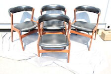 Set of 4 Vintage Teak Dining Chairs with Black Vinyl, characteristic o... Lot 77