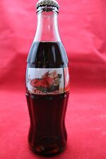 1995 Coca Cola Christmas Bottle Santa in Chair