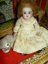 "Charming 4"" German wire-jointed, antique all bisque dollhouse doll w/glass eyes"