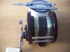 Penn 85 multiplier sea fishing reel with new line and fishing pliers