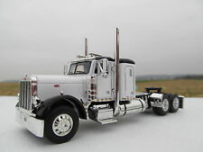 DCP 1/64 SCALE 379 PETERBILT SMALL BUNK WHITE  WITH BLACK TOP AND FENDERS