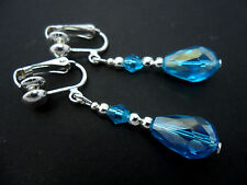A PAIR OF BLUE CRYSTAL  SILVER PLATED CLIP ON TEARDROP  EARRINGS.