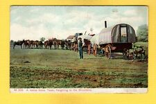 A Twelve Horse Team Freighting to the Mountains, covered wagon & 3 wheeled cart