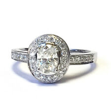 1.00 Carat Oval Diamond Halo Set Engagement Ring Crafted in 18k White Gold.