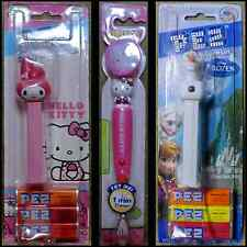 NEW - Hello Kitty Pez Dispenser and Timed Toothbrush and An Olaf Pez Dispenser