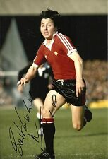 A 12 x 8 inch photo featuring & signed by Mickey Thomas at Manchester United