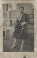 VINTAGE POST CARD IMAGE OF AN AFRICAN AMERICAN WOMAN DRESSED BEAUTIFULLY.