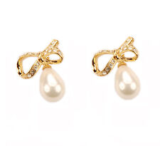 Con Mi Go London E110090 sparkling bow earrings with tear drop pearls