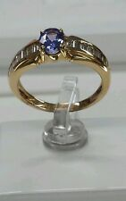 14k yellow gold Ring with 0.75ct baggates diamonds and 6x4mm oval tanzanite
