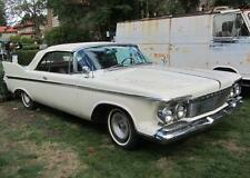 Old Photo.  White 1961 Imperial Automobile