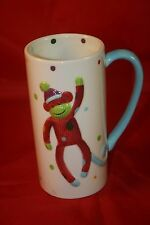 St Nicholas Square Red and Blue Sock Monkey Tall White Ceramic Coffee Mug Teacup