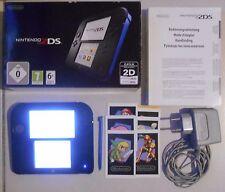 Console Nintendo 2DS noire et bleue en boîte avec chargeur et stylet