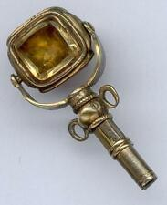 Unusual Small gilt Pocket Watch key with a Three Stone Swivel Base. Circa 1850