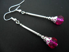 A PAIR OF DANGLY BRIGHT PINK CRYSTAL BEAD  SILVER PLATED DROP  EARRINGS.