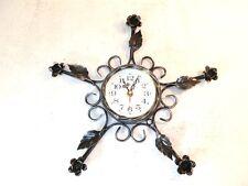 Orologio da parete con movimento al quarzo in ferro battuto con decoro in ferro