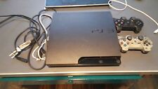 Sony PlayStation 3 Slim 320 GB PS3 (CECH-3001B) controllers and games