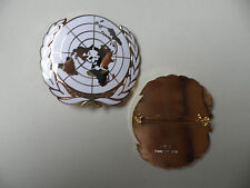 United Nations beret badge. New & unissued.