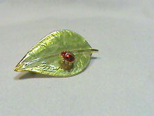 Light green laminated Leaf with Red Lady Bug Brooch signed LIA