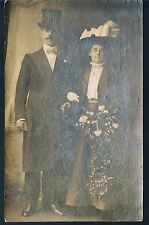 STUDIO POSTCARD ELEGANT EDWARDIAN COUPLE WITH HATS WISHING YOU A HAPPY XMAS RP