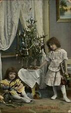 Christmas - Little Girls & New Toys Old Tennis Racket? C1910 Postcard