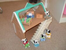 Sylvanian Families house with Cow family and furniture.