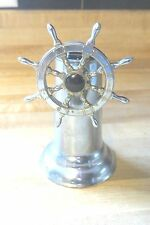 Ship or sailboat sailing steering wheel turn the wheel to light table lighter