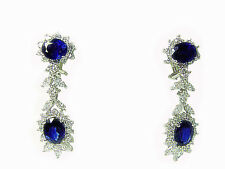 4 OVAL BLUE SAPPHIRES SET WITH MARQUISE AND ROUND BRIL