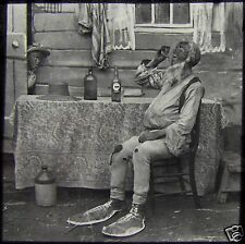 Glass Magic Lantern Slide MAN WITH GIANT SHOES DRINKING C1890 PHOTO