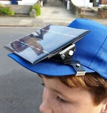 Solar charger for mobile phone: clips to your cap 2 Watts power, self assembly.