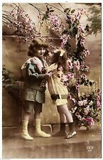FRANCE - Two Children about to Kiss - Dix 177- c1910s Real Photo postcard