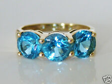Beautiful 9ct Gold Blue Topaz Trilogy Ring Size K