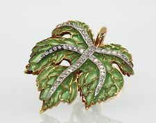 PLIQUE A JOUR EARRINGS DESIGNED AS LEAVES WITH DIAMONDS THROUGHOUT CIRCA 1950'S