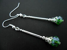 A PAIR OF DANGLY GREEN CRYSTAL BEAD  SILVER PLATED DROP EARRINGS.