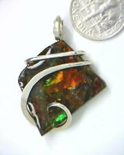 30.24ct Polished Ammolite Shell Section Pendant in Sterling Silver Wrap