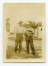 1930s vintage b/w snapshot  photo Two men drinking from a bottle