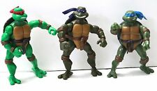 THREE MIRAGE STUDIOS PLAYMATE TOYS TEENAGE NINJA TUTLES. WITH EXTRA WEAPONS.